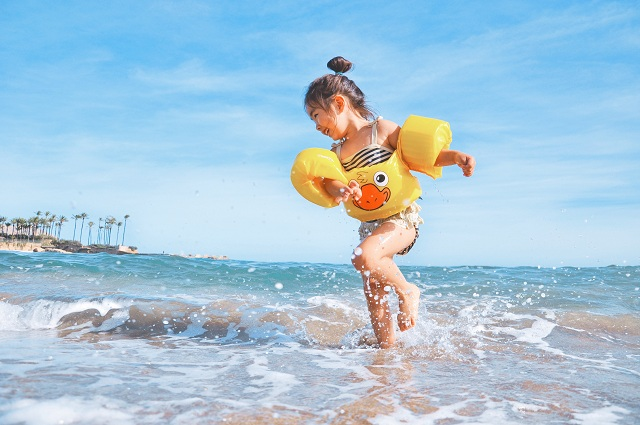 little-girl-rejoicing-summer-in-water