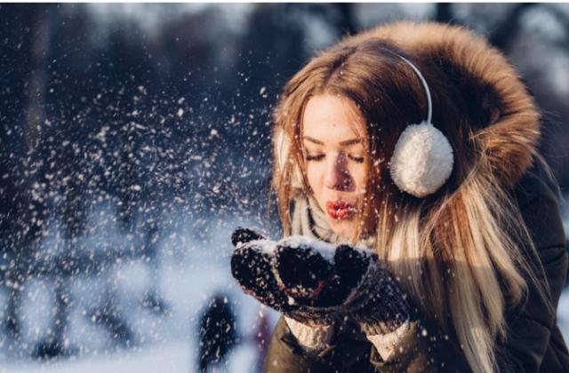 girl-enjoying-snowfall