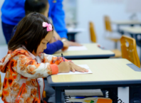 little-school-girl-writing